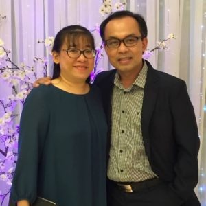 Joshua and his wife Linh